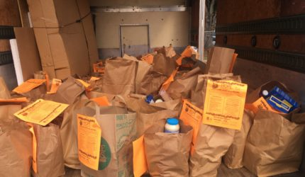 Truck full of bagged food for food drive