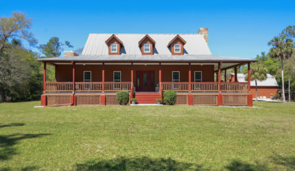 Front of 2-story house in Florida with wraparound porch